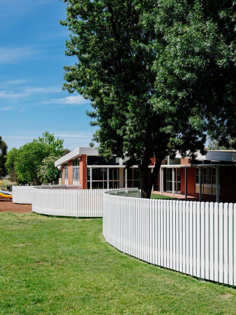 Picket fence balloons around playground